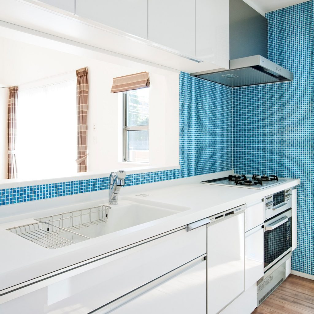 Blue tile and white kitchen